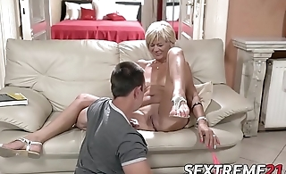 Horny granny enjoys riding coupled with sucking big young dick