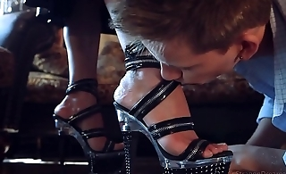 Latex mistress stiletto feet worship and hard strapon fucking.