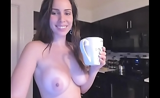 Blonde girl naked in the kitchen