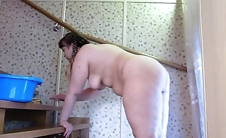 Sexy bbw with a chubby ass in a short skirt washes put emphasize stairs and gradually undresses.