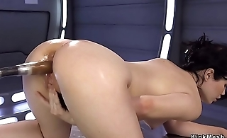 Brunette on her knees and hands fucks machine